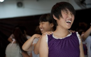 Two young Chinese women laughing